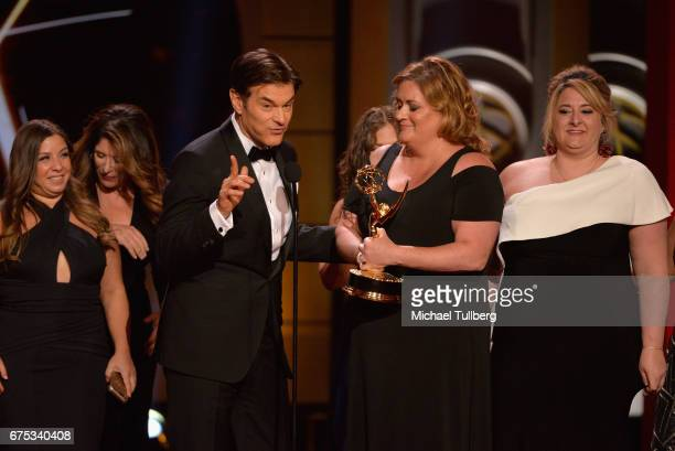 Dr Mehmet Oz reacts to winning the award for outstanding informative talk show for 'The Dr Oz Show' at the 44th annual Daytime Emmy Awards at...