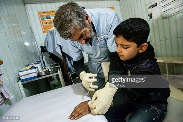 Dr Merajuddin makes injection from leishmania most common infection in Afghanistan in leishmania department of Central Hospital of Afghan Red...