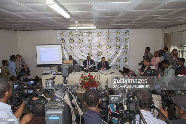 Dr Merga Bekena president of the National Electoral Board of Ethiopia reads on 27 May 2015 in Addis Ababa the preliminary results of the 5th...