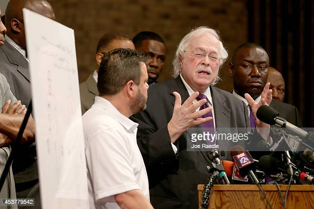 Dr Michael Baden a medical examiner who carried out the autopsy on Michael Brown speaks about the autopsy as family attorney's Benjamin Crump looks...