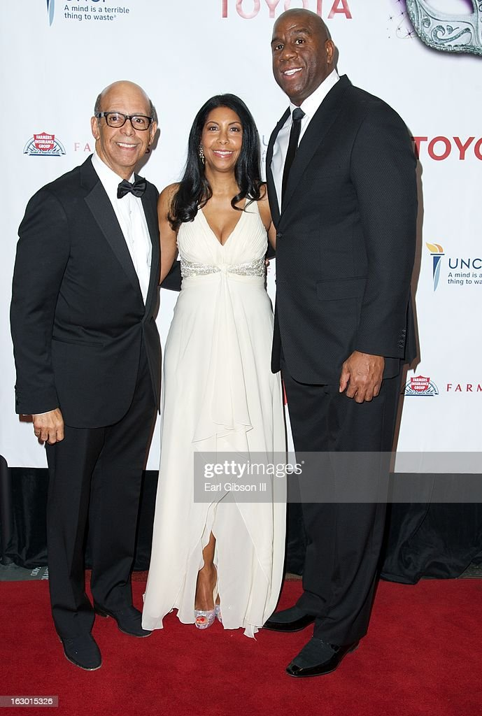 Dr. Michael Johnson (President of UNCF), Cookie Johnson and Earvin Magic Johnson pose for a photo on the red carpet of the UNCF Mayor's Masked Ball Hosted By Mayor Antonio Villaraigosa at Hilton Universal City on March 2, 2013 in Universal City, California.