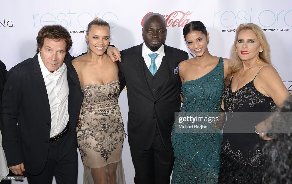 Dr. Michael Obeng (M), Mark B. Barron (L) and guests arrive at R.E.S.T.O.R.E: The Foundation For Reconstructive Surgery Charity Event on March 19, 2016 in Los Angeles, California.