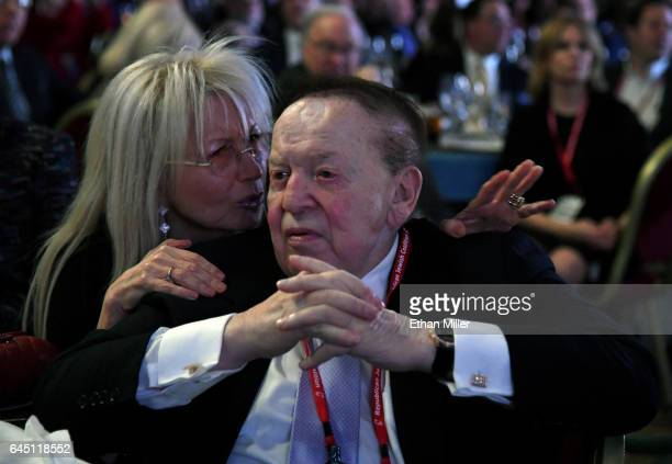 Dr Miriam Adelson talks with her husband Las Vegas Sands Corp Chairman and CEO Sheldon Adelson during a speech by US Vice President Mike Pence at the...