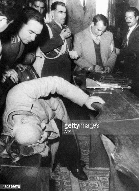 Dr Mohammad Mossadegh former Iran Prime Minister lies during his trial in a military court 12 November 1953 He was sentenced to three years...