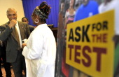Dr Mohammad N Akhter rubbed a swap on his gums as he took the HIV test after a press conference on the new HIV/AIDS testing initiative aims to test...