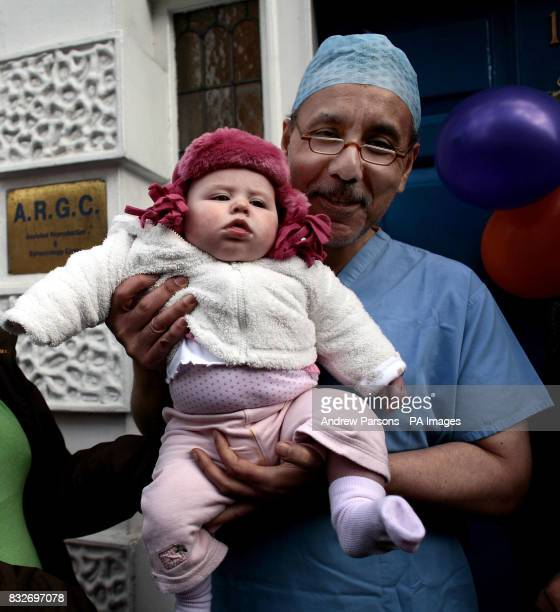 Dr Mohammed Taranissi holds Madeleine Cohen six months from Bournemouth as mothers and babies stage a Protest Party to demonstrate against the...