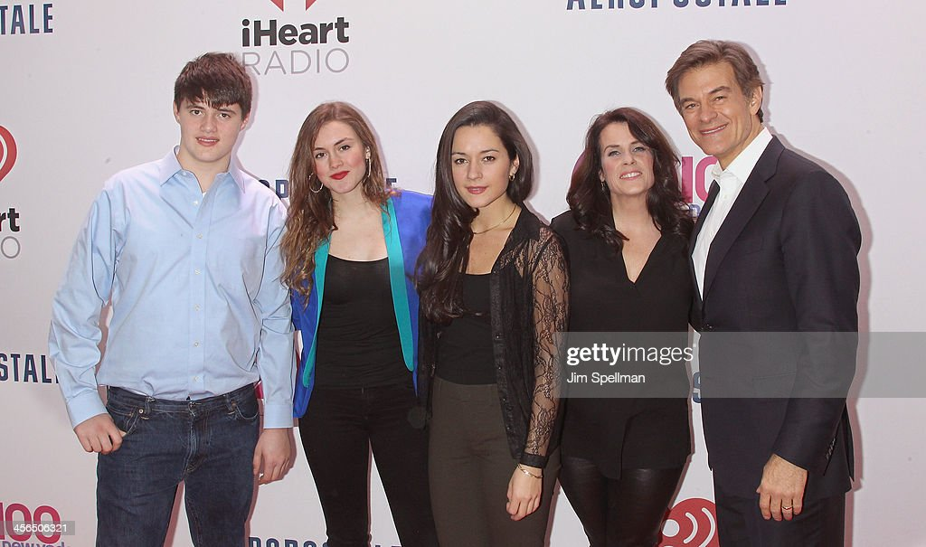Dr. Oz (R) and family attends Z100's Jingle Ball 2013 at Madison Square Garden on December 13, 2013 in New York City.