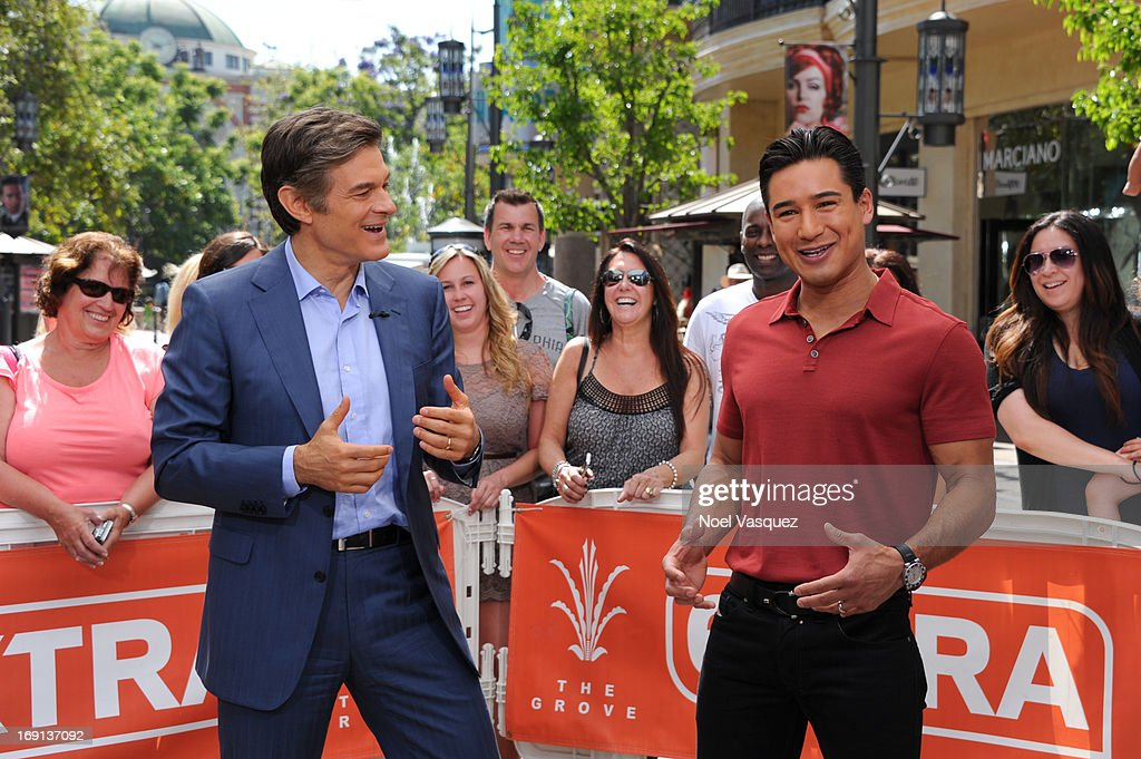 Dr. Oz (L) and <a gi-track='captionPersonalityLinkClicked' href=/galleries/search?phrase=Mario+Lopez&family=editorial&specificpeople=235992 ng-click='$event.stopPropagation()'>Mario Lopez</a> visit 'Extra' at The Grove on May 20, 2013 in Los Angeles, California.
