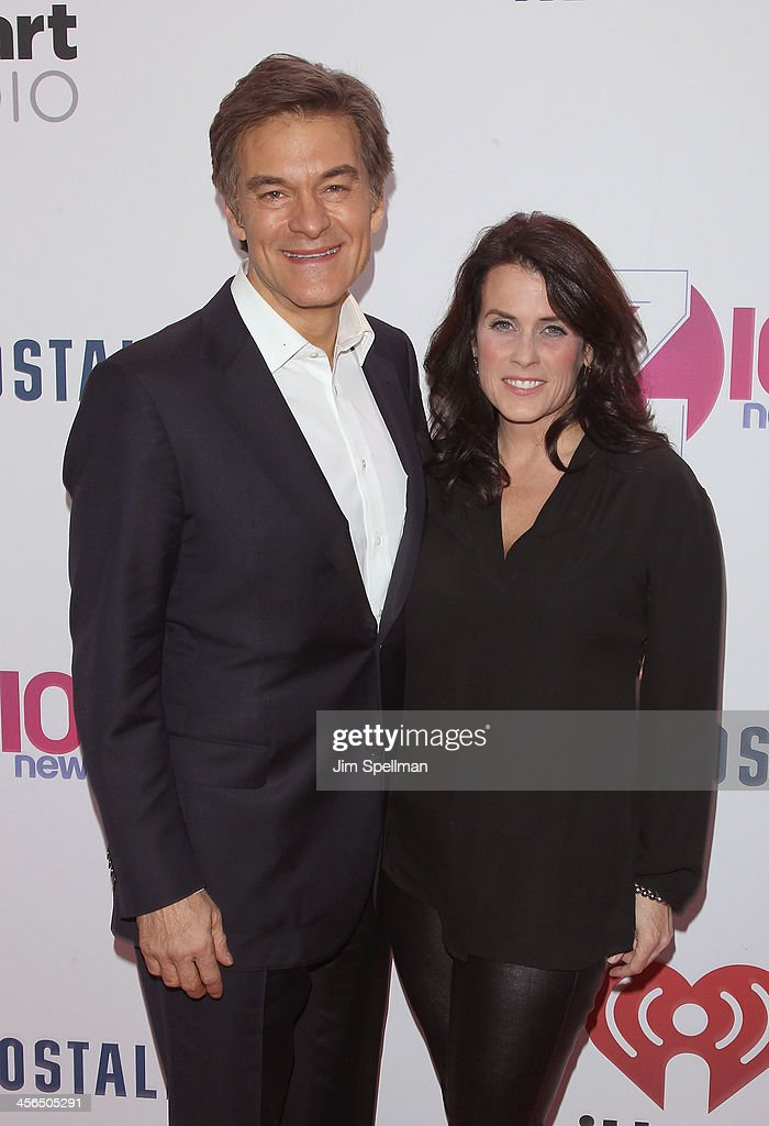 Dr. Oz and wife Lisa Oz attend Z100's Jingle Ball 2013 at Madison Square Garden on December 13, 2013 in New York City.