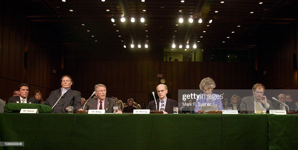 Dr. Paul Berg (third from left), from the Stanford University Medical School, testifies before the full committee hearing on Tuesday which examined the dangers of cloning and the promise of regenerative medicine, in the Hart Building.