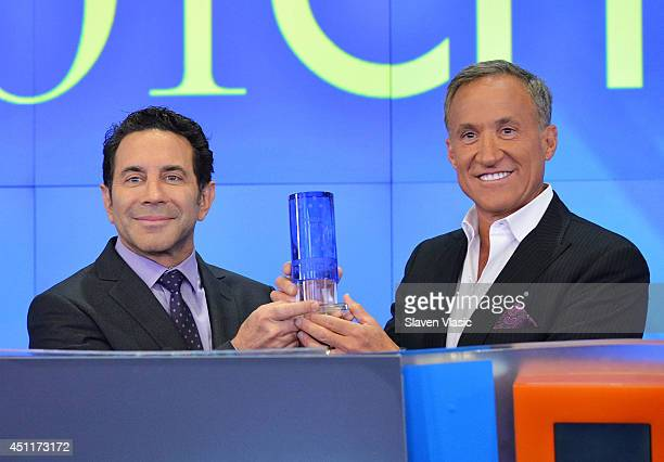 Dr Paul Nassif and Dr Terry Dubrow the cast members of 'Botched' ring the closing bell at NASDAQ MarketSite on June 24 2014 in New York City