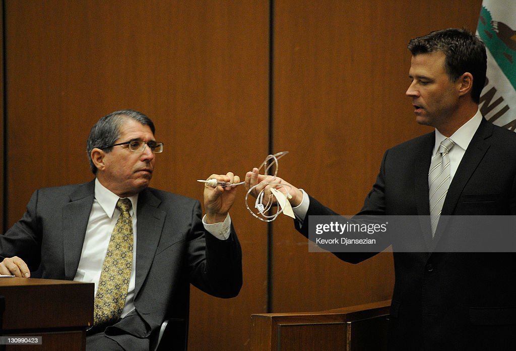 Dr. Paul White examines evidence presented to him by Los Angeles Deputy District Attorney David Walgren during the final stage of Conrad Murray's defense during his involuntary manslaughter trial in the death of singer Michael Jackson at the Los Angeles Superior Court on October 31, 2011 in Los Angeles, California. Murray has pleaded not guilty and faces four years in prison and the loss of his medical licenses if convicted of involuntary manslaughter in Jackson's death.