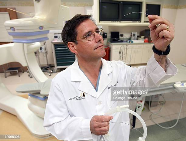 Dr Peter Kerwin Medical Director of the Cath Lab at Advocate Good Samaritan Hospital in Downers Grove holds a stent that the hospital uses on heart...