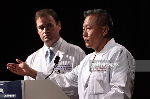Dr Peter Rhee chief of trauma at University Medical Center stands with chief neurosurgeon Dr Michael Lemole while briefing the media on the condition...