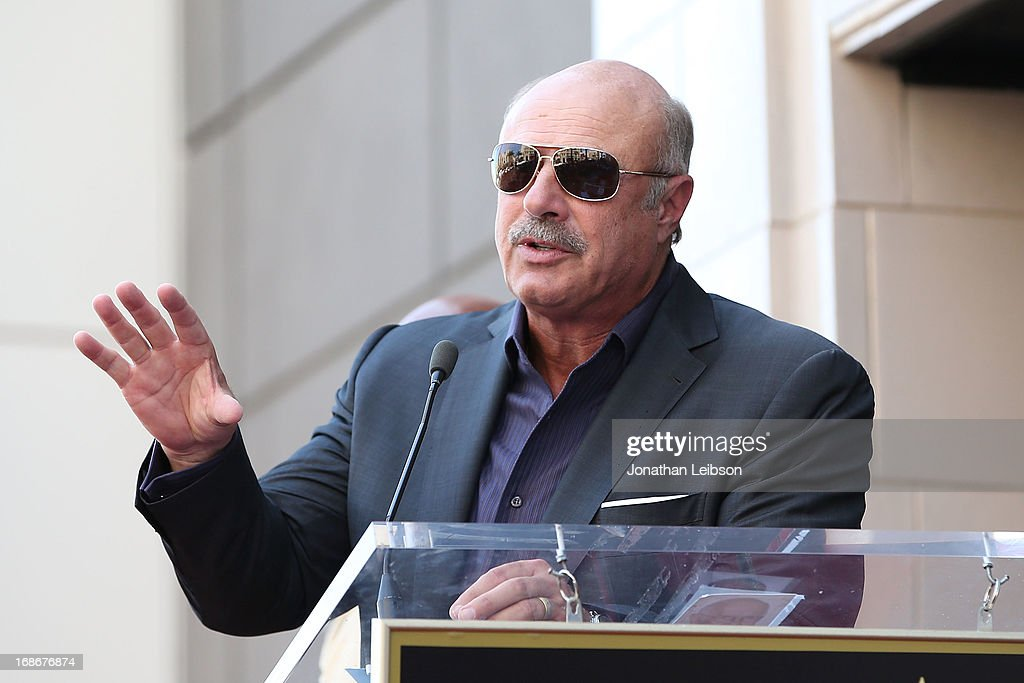 Dr. <a gi-track='captionPersonalityLinkClicked' href=/galleries/search?phrase=Phil+McGraw&family=editorial&specificpeople=234933 ng-click='$event.stopPropagation()'>Phil McGraw</a> attends the ceremony honoring Steve Harvey with a Star on The Hollywood Walk of Fame held on May 13, 2013 in Hollywood, California.