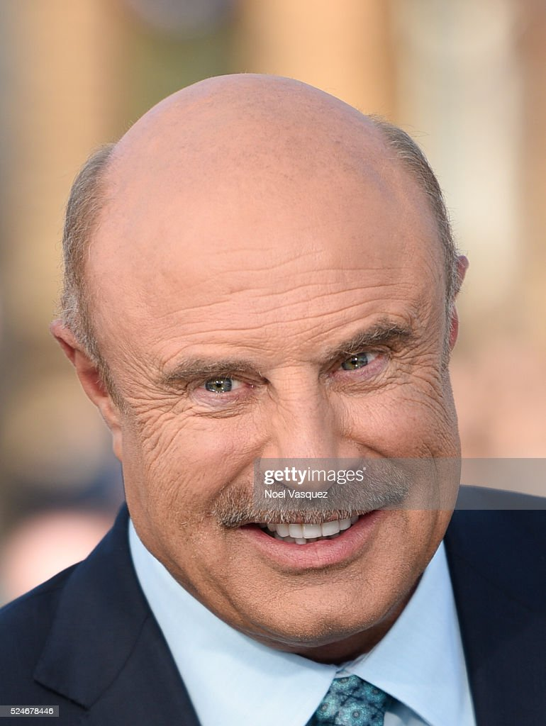 Dr. Phil visits 'Extra' at Universal Studios Hollywood on April 26, 2016 in Universal City, California.