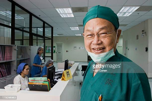 Dr Preecha Tiewtranon just outside the operating theatre at the Bangkok Nursing Home hospital in Thailand's capital Bangkok A Thai national Dr...
