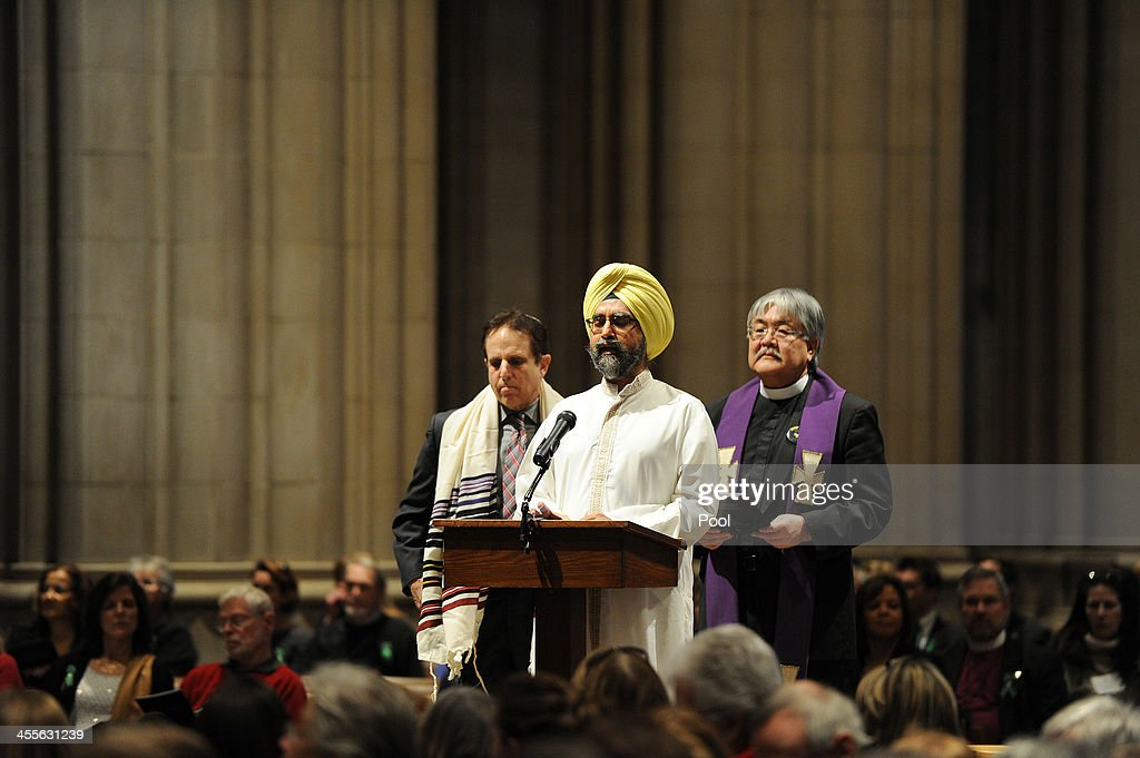 Dr. Rajwant Singh, founder and chairman of the Sikh Council on Religion and Education (SCORE), (C), speaks as he stands next to Rabbi Steve Gutow, president of the Jewish Council for Public Affairs, (Center L), and the Rev. Mel Kawakami, Sr. Minister of Newtown United Methodist Church in Newtown, CT, (R), during a National Vigil for Victims of Gun Violence just prior to the first anniversary marking the Sandy Hook Elementary School mass shooting at Washington National Cathedral on December 12, 2013 in Washington, DC. The event was to mark the one year anniversary of the December 14, 2012 shooting that killed 26 students and teachers at Sandy Hook Elementary School in Newtown, Connecticut.