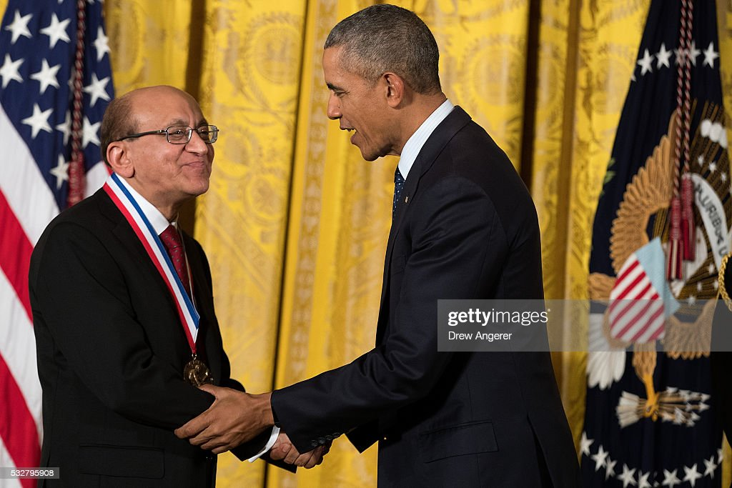 Dr. Rakesh K. Jain, from Harvard Medical School and Massachusetts General Hospital, shakes hands with President Barack Obama after receiving the National Medal of Science, during a ceremony in the East Room of the White House, May 19, 2016, in Washington, DC. Established in 1959, the National Medal of Science recognizes individuals who have made outstanding contributions to science and engineering. The National Medal of Technology and Innovation, created in 1980, recognizes those who have made contributions to America's competitiveness, quality of life, and helped strengthen the country's technological workforce.