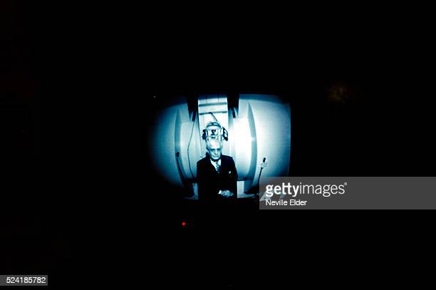 Dr Raymond Damadian is viewed through a protective screen on an MRI machine at his Long Island office A Biblebelieving Christian this inventor is...
