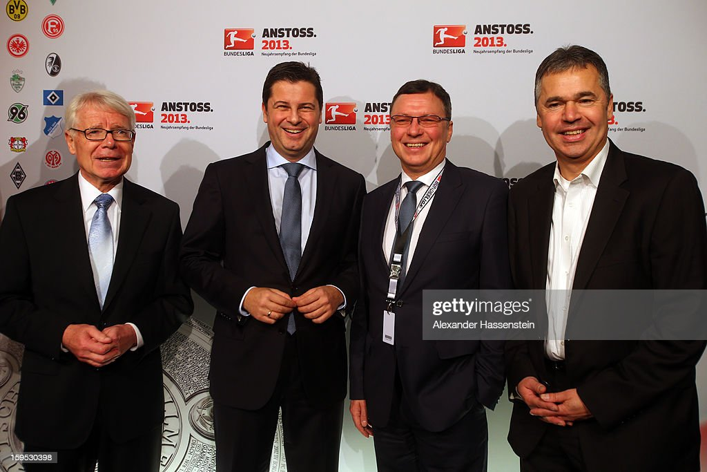 Dr. Reinhard Rauball (L) president of DFL, Christian Seifert (2nd L) chairman of business, Volker Herres (2nd R), ARD director and Andreas Rettig (R), manager of DFL pose during the DFL new year's reception at the Thurn und Taxis Palais on January 15, 2013 in Frankfurt am Main, Germany.