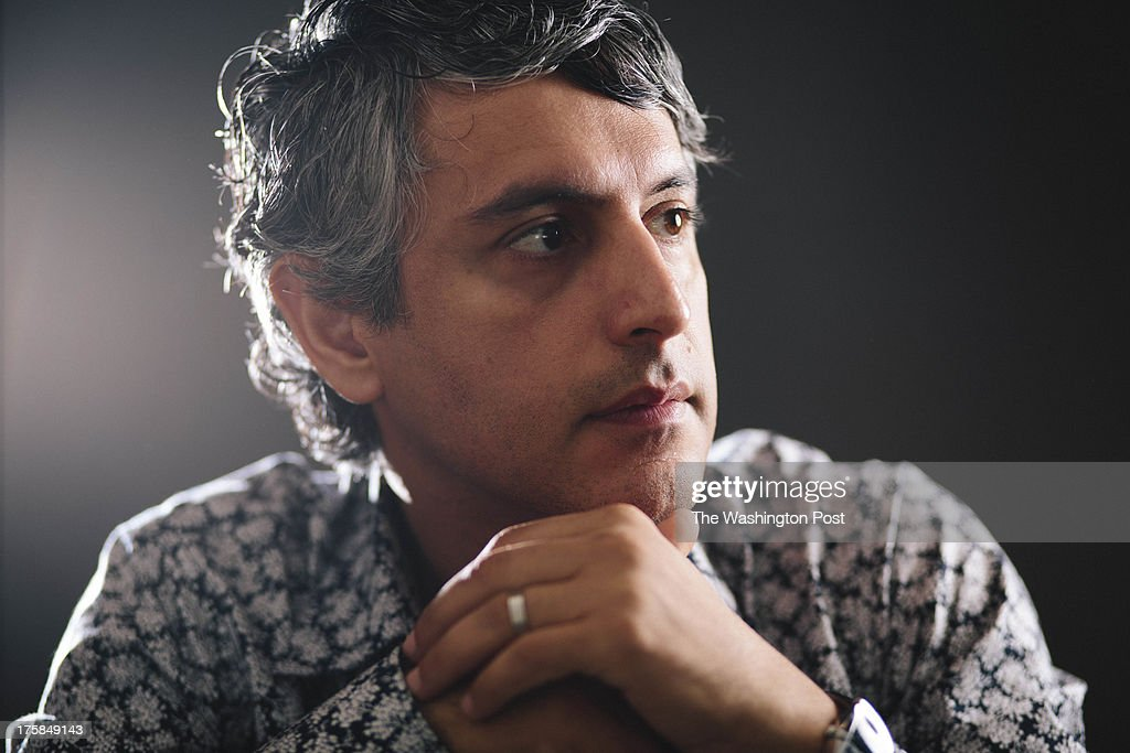 LOS ANGELES, CA - AUGUST 8, 2013 - Dr. Reza Aslan, author of the book 'Zelot' poses at his home on August 8, 2013, in Los Angeles, California. Dr. Aslan's doctorate in the sociology of religions encompasses expertise in the history of religion. Aslan's bachelor's degree is in religious studies, with an emphasis on scripture and traditions. His minor was in biblical Greek. He has a master of theological studies degree from Harvard University, in world religions, and a Ph.D. from the University of California, Santa Barbara, in the sociology of religions. Reza also has a master of fine arts degree from the University of Iowa. Dr. Aslan is currently associate professor of creative writing at the University of California, Riverside, and a cooperative faculty member in the department of religion, and he teaches in both disciplines. He was previously Wallerstein Distinguished Visiting Professor of religion at Drew University, where he taught from 2012 to 2013, and assistant visiting professor of religion at the University of Iowa, where he taught from 2000 to 2003. He has written three books on religion.