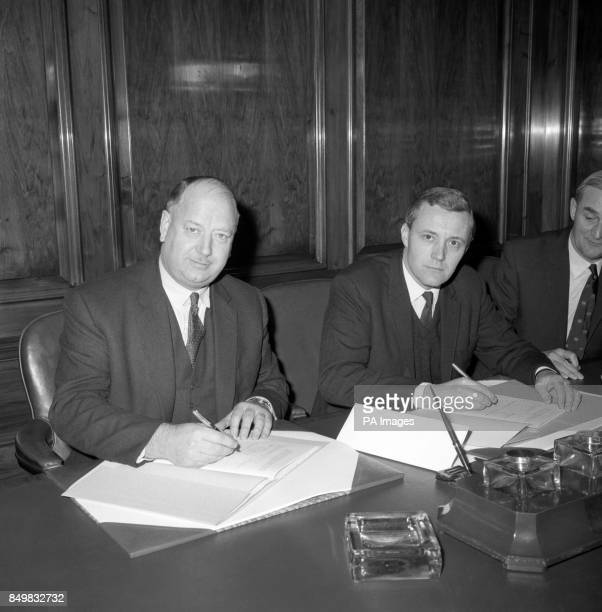 Dr Richard Beeching chairman of the British Railways Board and Anthony Wedgwood Benn the Postmaster General sign the 10year contract for the rail...