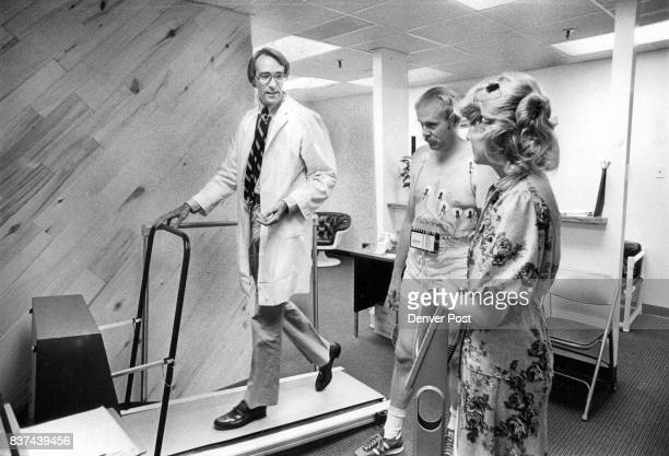 Dr Richard Flanigan shows George Shoemaker how to use treadmill for stress test as Mari Palmer watches Credit Denver Post
