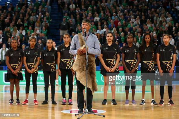 Dr Richard Walley performs the Welcome To Country during the round 14 Super Netball match between the Fever and the Vixens at Perth Arena on May 27...