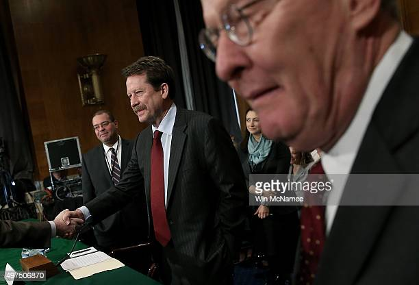 Dr Robert Califf greets members of Congress prior to his nomination hearing before the Senate Health Education Labor and Pensions Committee November...