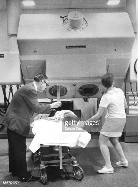 Dr Robert Lackey adjusts the betatron while technician Kathy Young tilts the machine to focus on the cancer of Richard Painter Richard Scottsbluff...