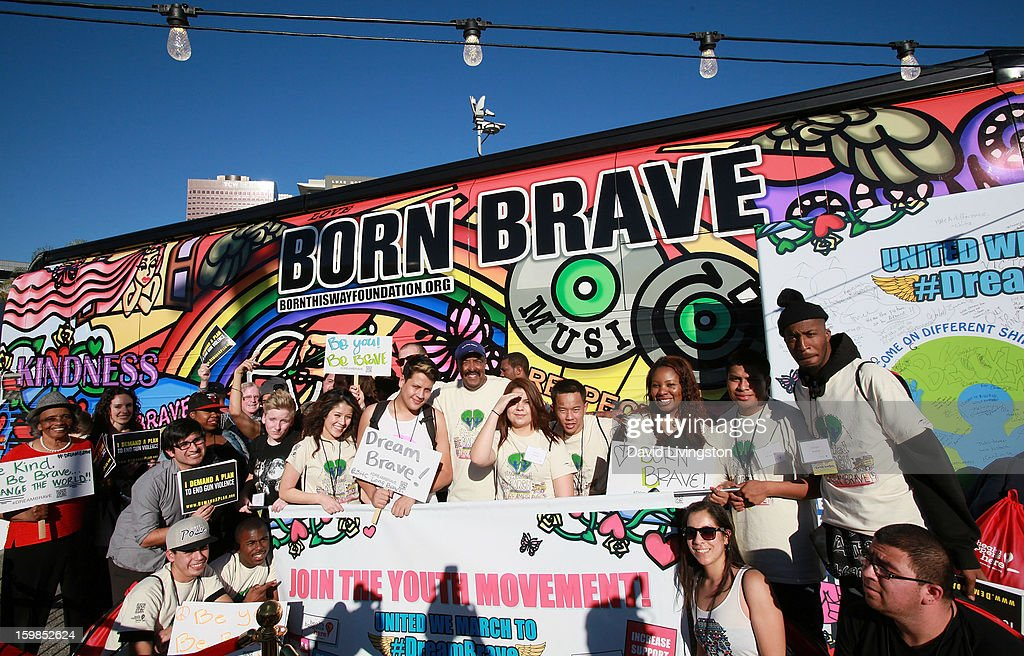 Dr. Robert Ross (C, in hat) and attendess pose at the Born This Way Foundation's 'Born Brave Bus' Pre-show Tailgate Party at STAPLES Center on January 21, 2013 in Los Angeles, California.