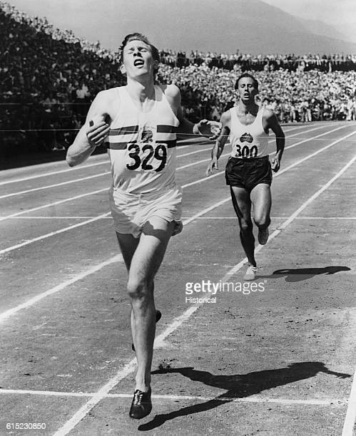Dr Roger Bannister hits the tape in the 1954 Miracle Mile race in Vancouver BC The neurologist became the first man to break the fourminute mile that...