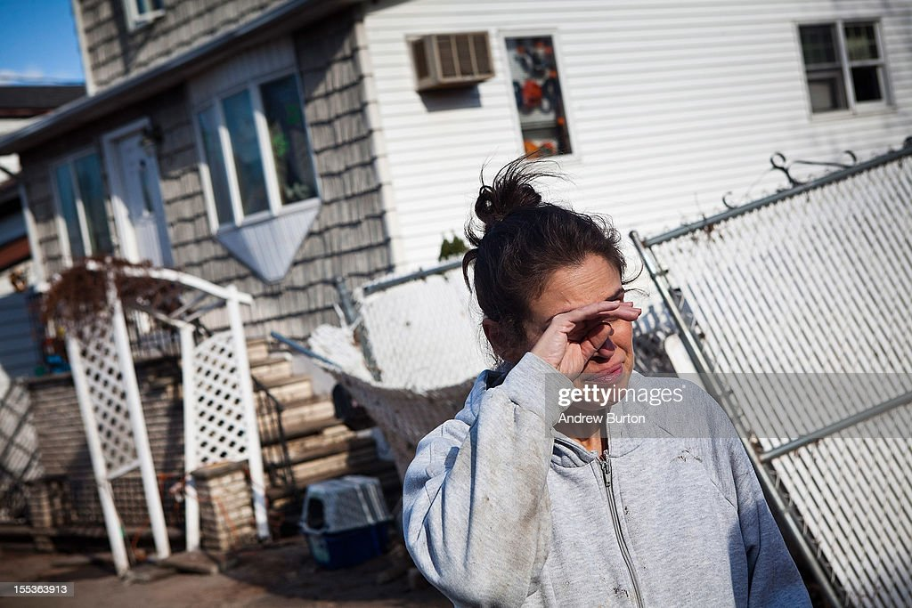 Dr Rosanna Troia breaks down in tears while helping clean out her mother's home in the Midland Beach neighborhood of Staten Island on November 3, 2012 in New York City. As clean up efforts from Superstorm Sandy continue, colder weather and another storm predicted for next week are beginning to make some worried.