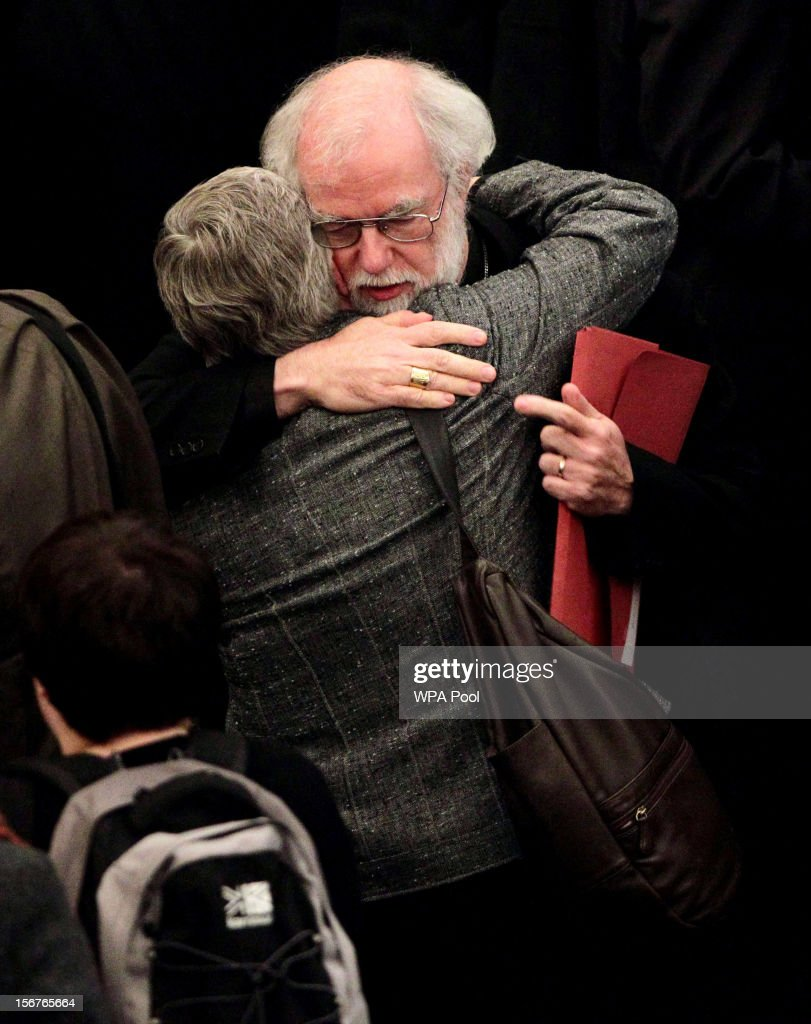 Dr Rowan Williams, the outgoing Archbishop of Canterbury, consoles a colleague after draft legislation introducing the first women bishops in the Church of England failed to receive final approval from the Church of England General Synod on November 20, 2012 in London, England. The Church of England's governing body, known as the General Synod, voted on whether to allow women to become bishops.
