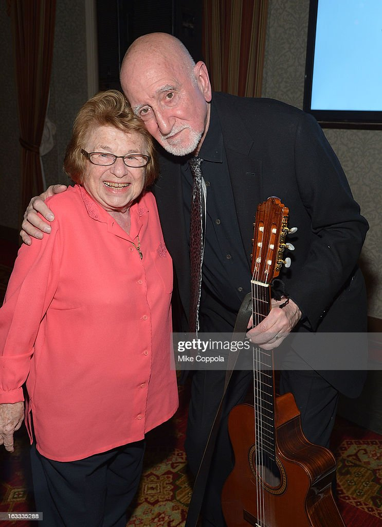Dr. Ruth Westheimer (L) and Dominic Chianese embrace after his performance the Table 4 Writers Foundation 1st Annual Awards Gala on March 7, 2013 in New York City.