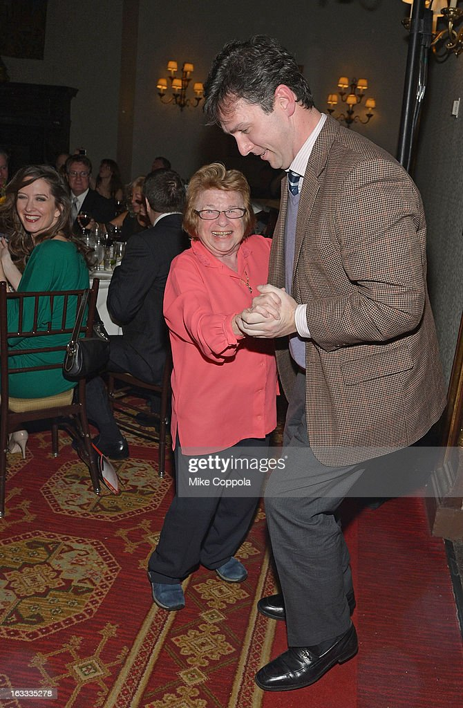 Dr. <a gi-track='captionPersonalityLinkClicked' href=/galleries/search?phrase=Ruth+Westheimer&family=editorial&specificpeople=216372 ng-click='$event.stopPropagation()'>Ruth Westheimer</a> (L) dances during a performance at the Table 4 Writers Foundation 1st Annual Awards Gala on March 7, 2013 in New York City.