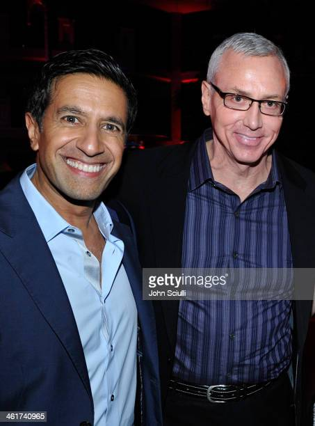 Dr Sanjay Gupta and Dr Drew Pinsky attend the 2014 TCA Winter Press Tour CNN AfterParty on January 10 2014 in Pasadena California