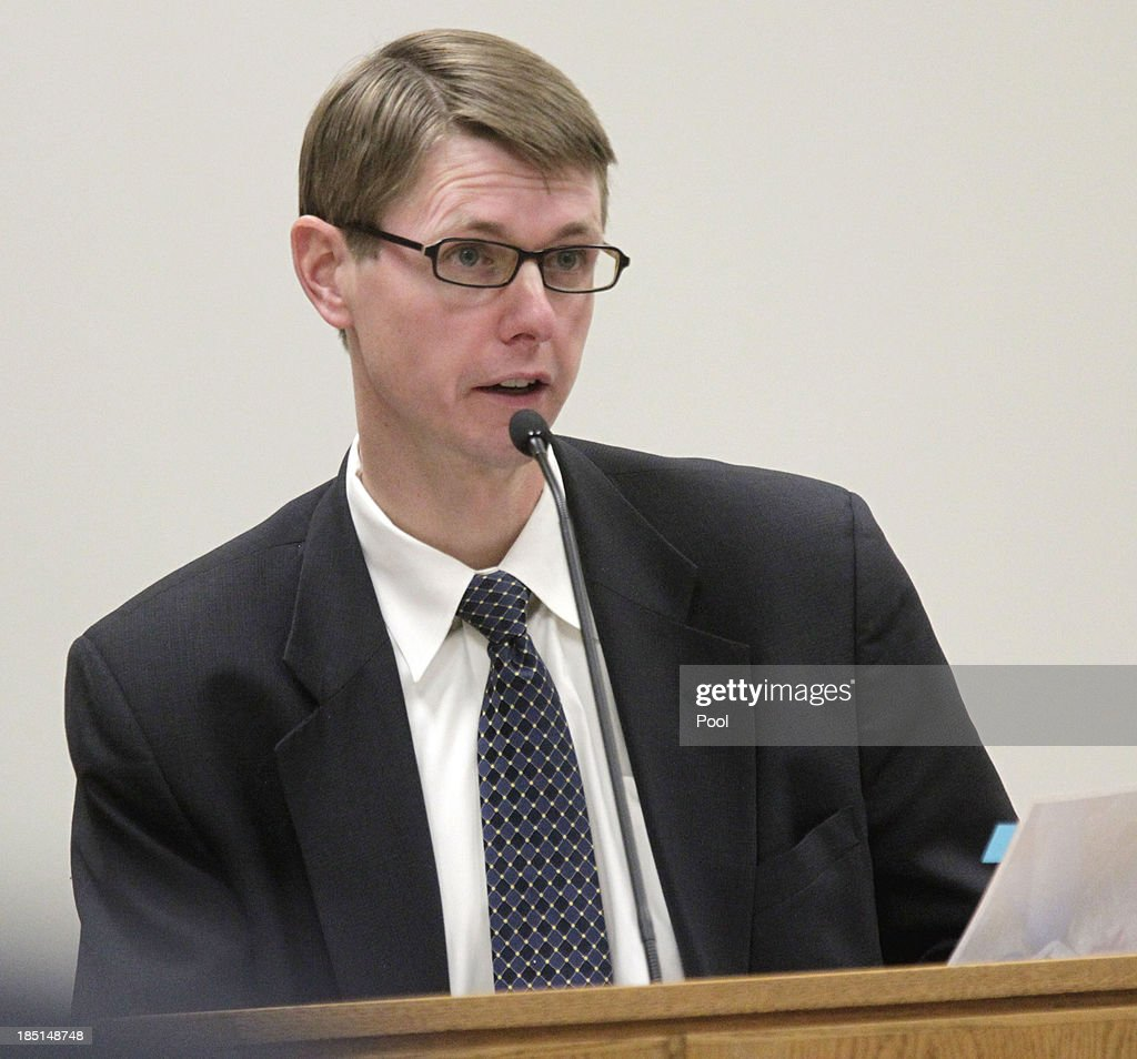 Dr. Scott Thompson testifies on the first day of the trial of Dr. Martin MacNeill on October 17, 2013 in Provo, Utah. Prosecutors allege MacNeill hounded his wife Michele MacNeill to get a face-lift in 2007 so he could kill her with a lethal dose of prescription drugs in an effort continue an affair with a younger woman.