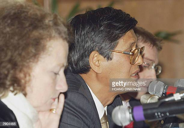 Dr Shigeru Omi Director of the World Health Organization Western Pacific Region answers journalists' questions as Pascale Brudon WHO Vietnam country...