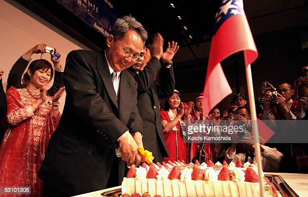 Dr Sin Wein the Prime Minister in Exile of the National Coalition Government of the Union of Burma cuts a birthday cake during Myanmar's opposition...