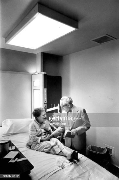 Dr Sol Bassow Chats with patient Anne Wittow The patient in hospital for cardiac tests says he cheers her up Credit Denver Post