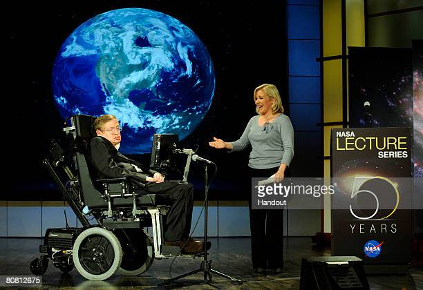 Dr Stephen Hawking professor of mathematics at the University of Cambridge and his daughter Lucy Hawking stand onstage April 21 at George Washington...