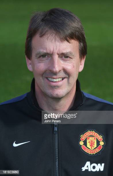 Dr Steve McNally of Manchester United poses at the annual club photocall at Old Trafford on September 26 2013 in Manchester England
