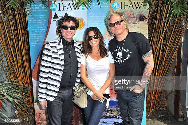 Dr Steven McCarthy actress Gina Gershon and musician Matt Sorum attend IFAW Adopt the Arts and the Los Angeles Unified School District's Love...