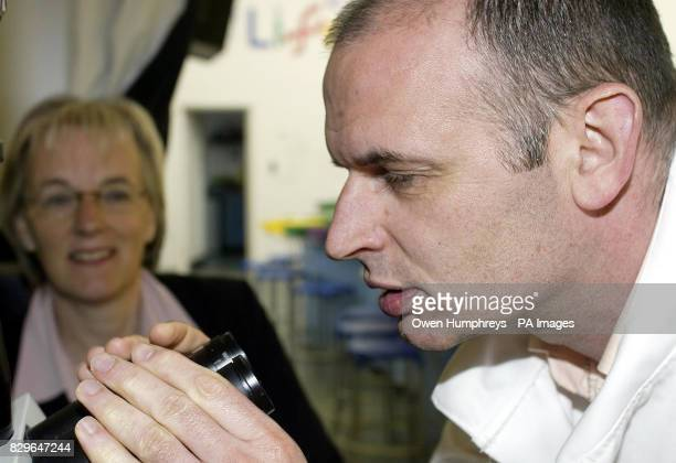 Dr Stojkovic looks through a microscope watched by Prof Alison Murdoch after a human embryo was cloned for the first time in Britain The breakthrough...