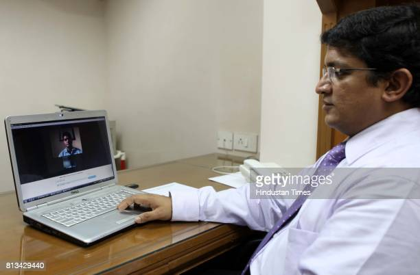 Dr Sunil Moreler consulting his patient Abhay Lohar through SKYPE at his Clinic on Thursday
