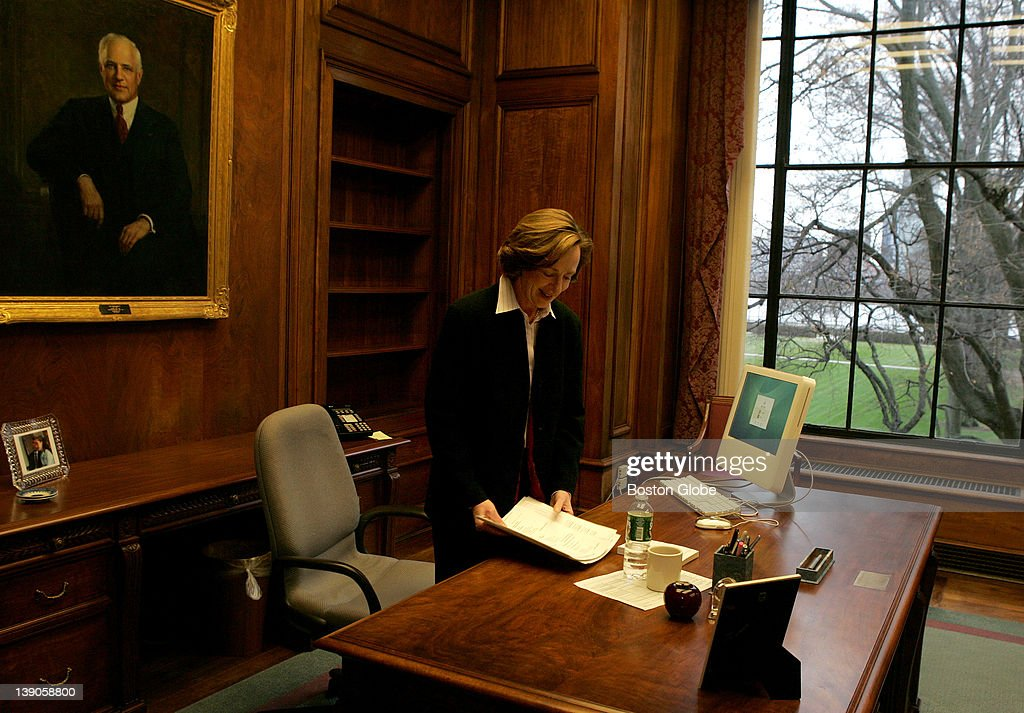 Dr. Susan Hockfield, MIT's new president, during her first day on the job. Here, she arranges her desk under the painting of former president Carl Compton (1930 - 1939).