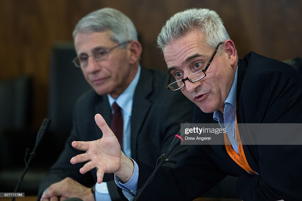 Dr. Sylvain Aldighieri, Zika Incident Manager for the Pan American Health Organization (PAHO) speaks as Dr. Anthony Fauci, director of the National Institute of Allergy and Infectious Diseases (NIAD) looks on during a media briefing concerning the Zika virus, at the Pan American Health Organization headquarters, May 3, 2016, in Washington, DC. Researchers have recently discovered the Zika virus in a second mosquito species. Known as the 'Asian Tiger' mosquito, (formally named Aedes albopictus) the species stretches much further north into the United States than the previously known Zika carrying Aedes aegypti species. The discovery was recently reported in the April 21 'Zika - Epidemiological Update' report issued by Pan American Health Organization and the World Health Organization.
