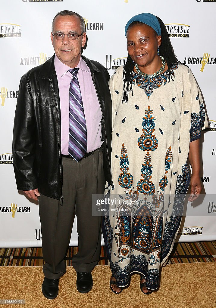Dr. Tererai Trent (R) and husband Mark Trent attend the 4th Annual Unstoppable Gala at the Beverly Wilshire Four Seasons Hotel on March 16, 2013 in Beverly Hills, California.